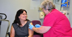VA Assistant Secretary Tammy Duckworth receiving a flu shot