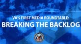 """People sitting in a conference room with American Flag in the foreground - Text Reads - """"VA'S FIRST MEDIA ROUNDTABLE: BREAKING THE BACKLOG"""""""