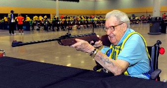 Picture of Jack Faust - Elderly man in a wheel chair aiming a rifle.