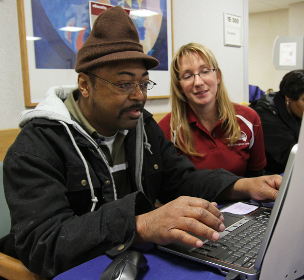 Winterhaven volunteer Sharon Friel (right) helps a Veteran sign up for eBenefits during the stand down at the Washington, D.C., VA Medical Center.