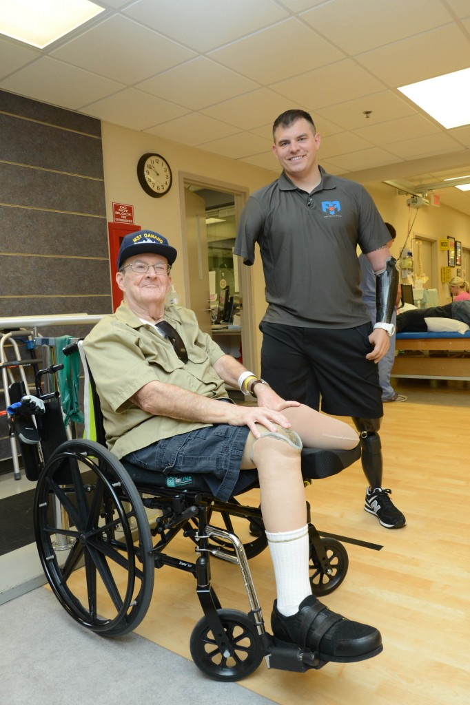 "Travis Mills with Navy Veteran Stephen Thomas. Mills met with fellow Veterans at the Rehabilitation Clinic where he conveyed his ""Never give up—Never quit"" mantra that continues to drive him through life. (VA Photo/Ken Holt)"