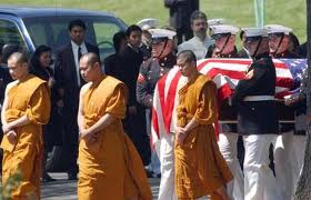 Buddhist monks accompany the casket of Thai-American Cpl. Kemaphoom, Chanawongse, a U.S. Marine killed in action in Iraq.