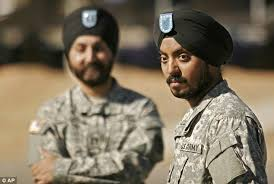 Now-Maj. Kamaljeet Singh Kalsi (left) and Cpl. Guneet Lamba are two of the three Sikh-Americans serving in the U.S. Army.