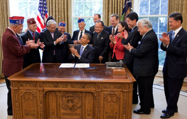 In 2011, surviving Japanese-American Veterans were recognized with the Congressional Gold Medal, pictured here with President Obama during the signing ceremony.