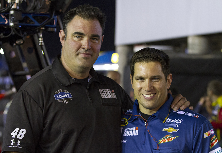 Chris Clayton (right) stands with Hendrick Motorsports pit-crew coach Greg Morin at Charlotte Motor Speedway. Morin gave Clayton a chance to try out for the team.