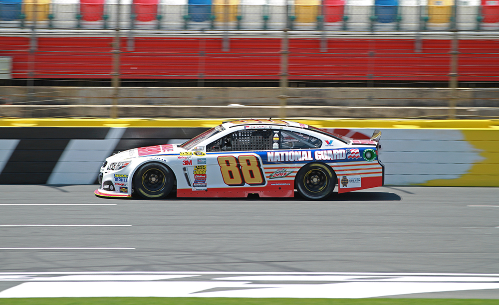 Dale Earnhardt Jr. speeds around the track in the #88 National Guard Chevy at Charlotte Motor Speedway.