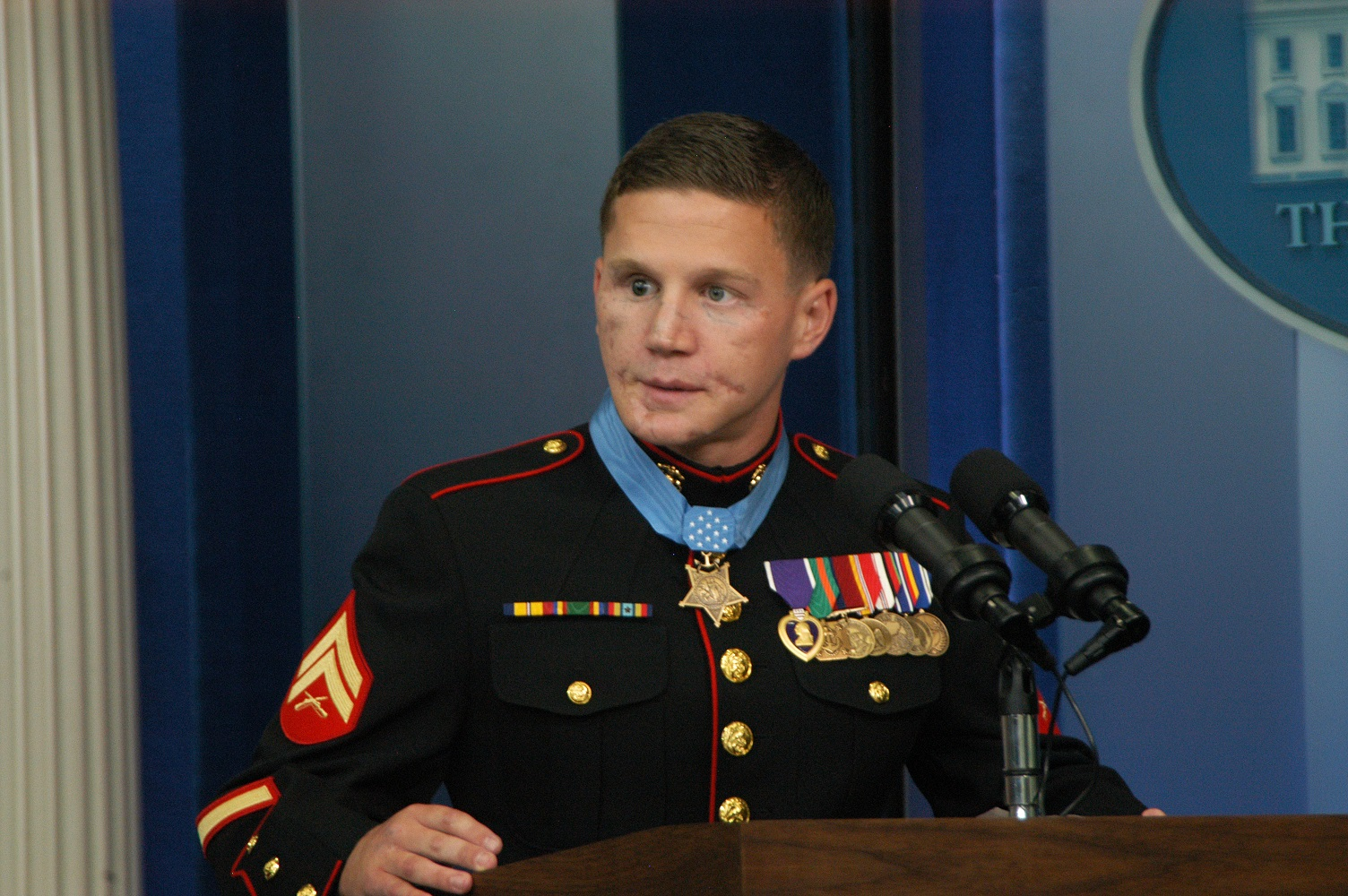 "Retired Marine Corporal William ""Kyle"" Carpenter gives a statement after receiving the Medal of Honor at the Whilte House June 19."