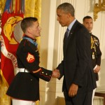 "President Obama shakes the hand of retired Marine Corporal William ""Kyle"" Carpenter after presenting him with the Medal of Honor during a June 19 ceremony at the White House."