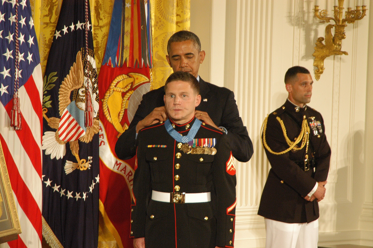 "Retired Marine Corporal William ""Kyle"" Carpenter receives the Medal of Honor from President Obama in a June 19 ceremony at the White House."
