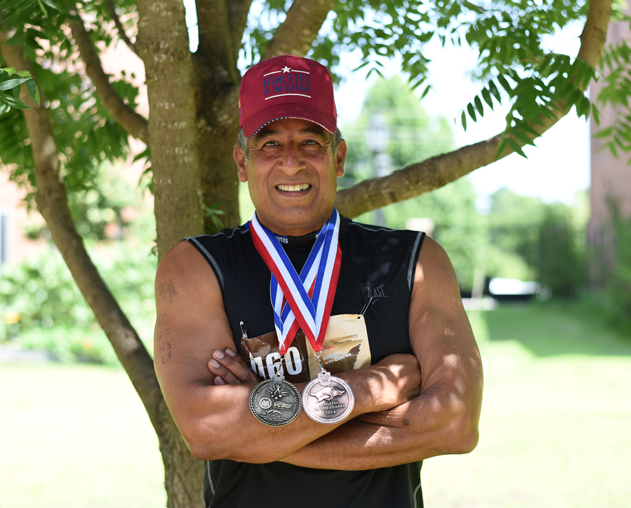 John Martinez earned a medal with eight of ten events.