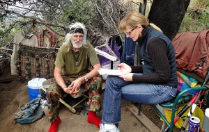 "Kerry Morrison, who heads two Hollywood business improvement districts,  surveys John Watkins about his health and housing situation in Watkins' mountain hideway. This interview took place April 2010. One year later Watkins is living in his own apartment. Watkins spent 14 years living in the mountains and was known as the ""Godfather"" of the Hollywood Hills."