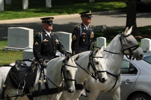 Staff Sgt. John Ford (r) rides in formation during a ceremony at Arlington.