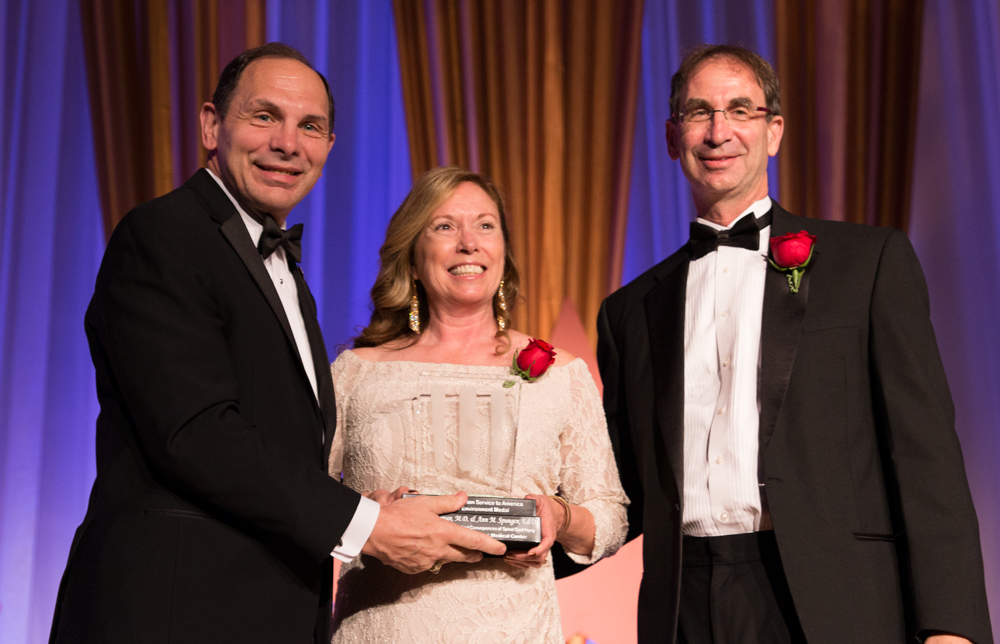 Sec. Bob McDonald (left) presents the Service to America Science and Environment Award to Ann Spungen, Ph.D., and William Bauman, M.D., for their work with paralyzed Veterans during the 2014 Sammies in Washinginton, D.C. (REYNALDO LEAL/U.S. Department of Veterans Affairs)