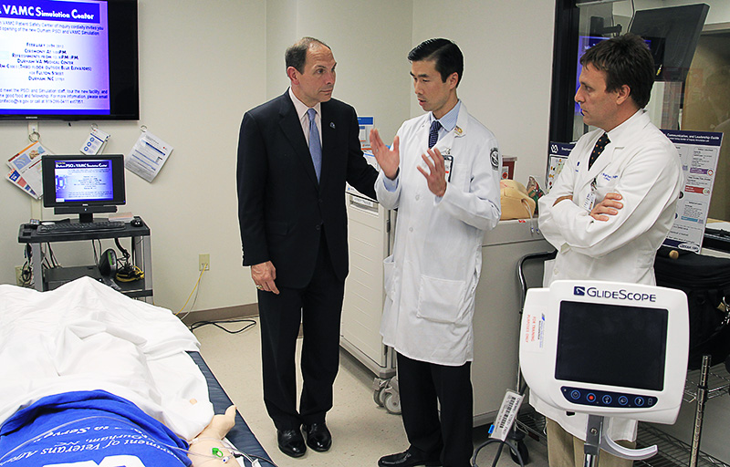 Sec. Bob McDonald (left) speaks with Dr. Chan Park (middle) and Dr. Atilio Barbeito about the Durham VAMC Simulation Center and how it helps physicians care for Veterans. (REYANLDO LEAL/U.S. Department of Veterans Affairs)