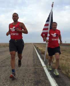 Mike Morton (right) and Dave James (left) move Old Glory through eastern Colorado.