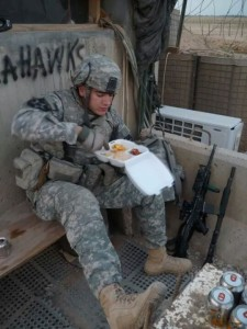 Dan Burke of the 2nd ID 3rd SBCT 1-23INF BCO celebrates Turkey Day 2009 in Iraq. Photo by Nathan Marques.