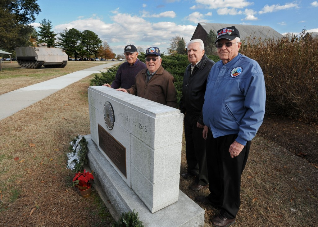"(L to R) Alfred Shebab, Mike Levin, John Schaffner and Douglas Dillard pause for photo at the Veterans of the Battle of the Bulge memorial at Fort Meade, Maryland.  The four Veterans discussed their experiences in Europe during World War II for VA's ""Living History: Battle of the Bulge"" feature, which premieres in January 2015."