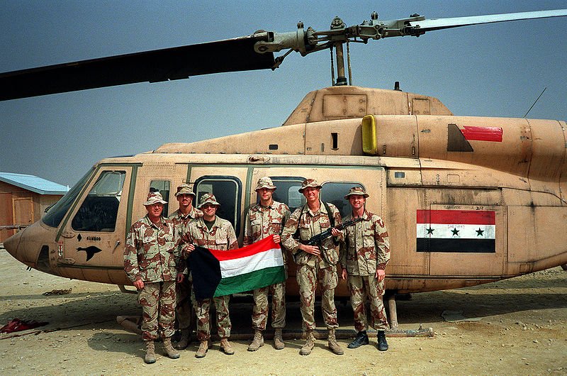800px-Members_of_the_staff_of_the_3rd_Marine_Aircraft_Wing_stand_in_front_of_a_captured_Iraqi_Bell_214ST_Transport_helicopter_during_Operation_Desert_Storm