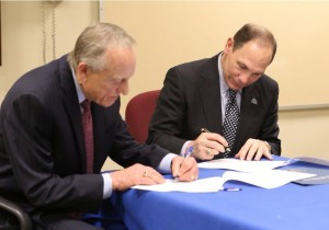 Secretary Bob signing papers