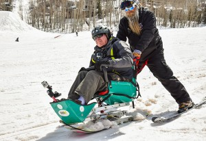 Veterans participating in downhill skiing.