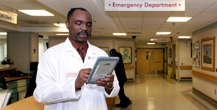 Doctor on tablet.
