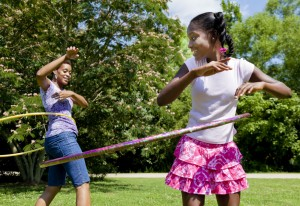 mother and daugther using hula hoops