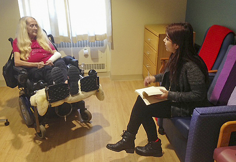 woman in wheelchair talking with another woman