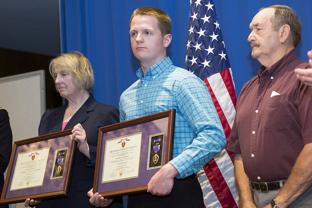 The Seager family holds the Purple Hearts presented by the Army and Department of Veterans Affairs.