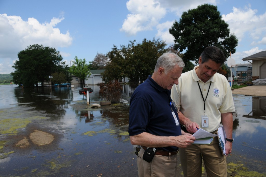 Spring Green, Wisconsin, July 22, 2008 -- FEMA Operation's Chief for Wisconsin Steve Bolton, shows FEMA's Federal Coordinating Officer for Wisconsin a list of approximately 19 surrounding homes in the Township of Spring Green that were flooded five weeks ago and have remained uninhabitable.  Sewage and infectious algae growth have become a major problem in this particular housing development.