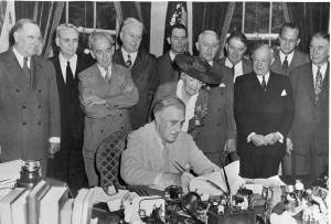 President Franklin D. Roosevelt signs the G.I. Bill in the Oval Office, June 22, 1944.