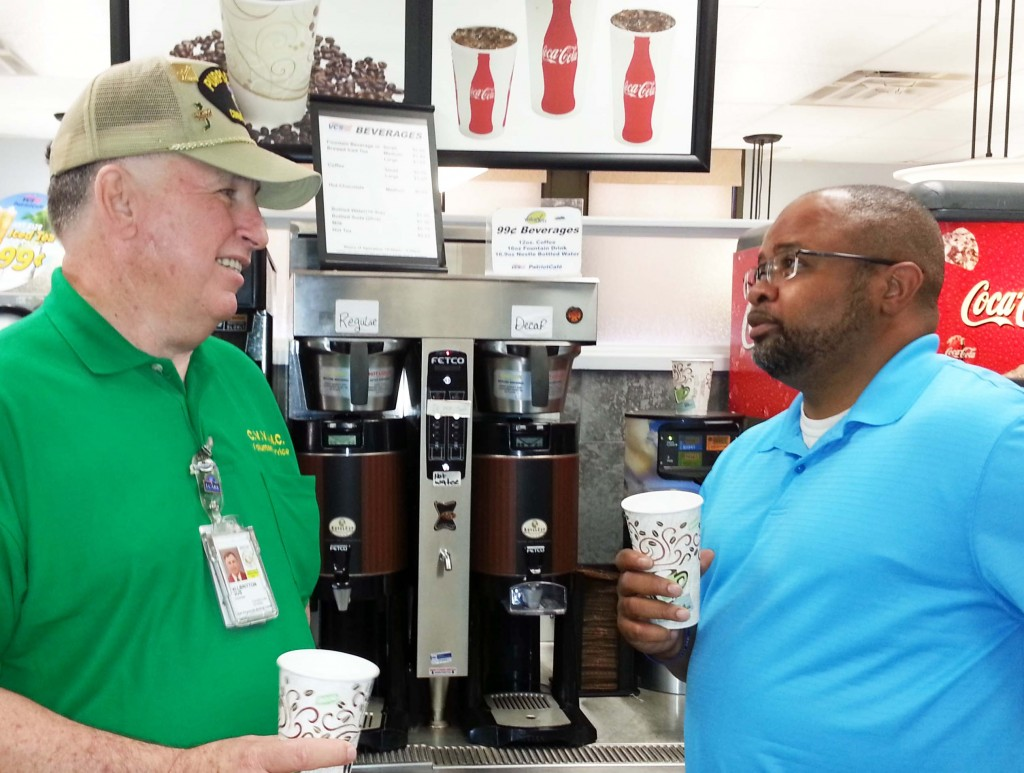 Image of two Veterans drinking coffee.