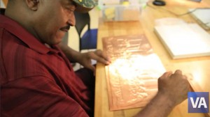 Veteran works on his copper matting project at the Tampa VA