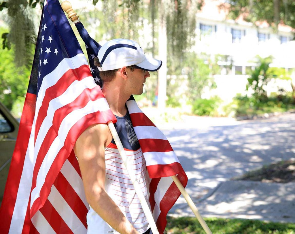 U.S. Air Force Reserve Senior Airman Tanner Spaulding participates in the moving flag 911 tribute.