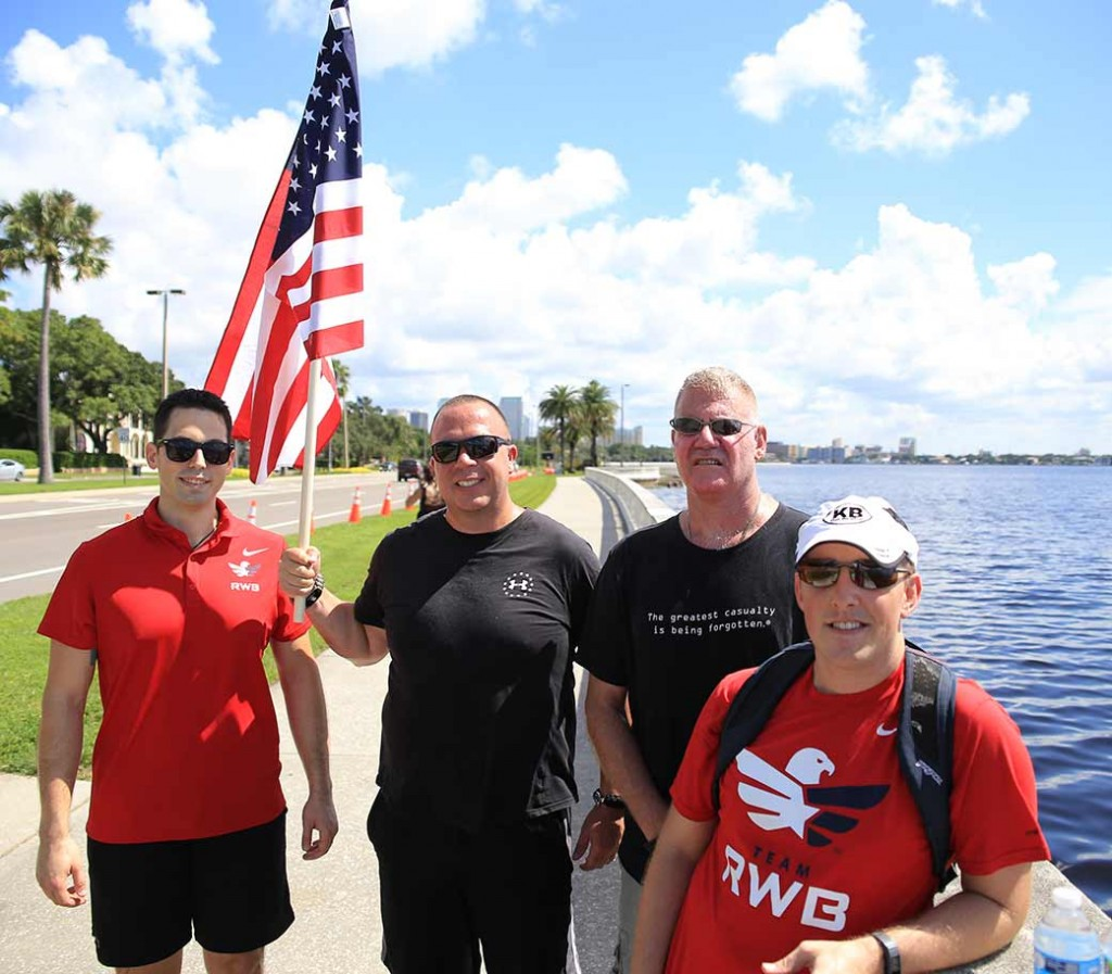 Veterans take a quick break while carrying the flag, nearly 200 miles all together.
