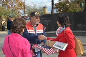 Author Melodee Mercer greets a Vietnam Veteran.