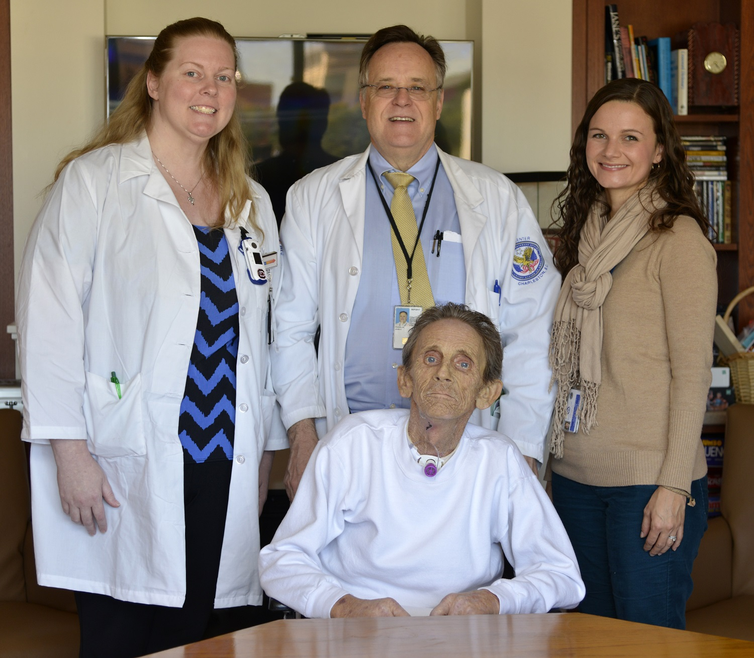 Veteran Robert Smith (seated) surrounded by some members of his care team: Jennifer Crosby, RN; John Franklin, MD; Kelli Williams, MSW