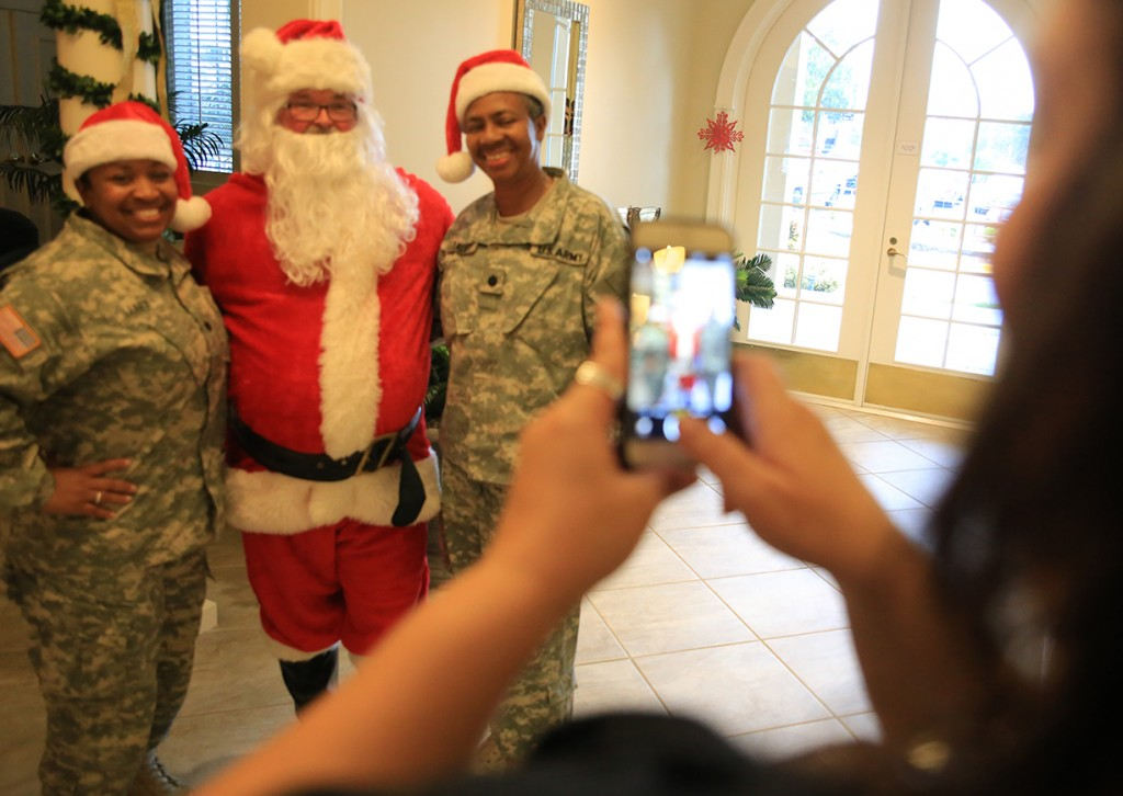 Servicemembers pose with Santa at the Tampa VA Fisher House