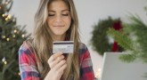 Young woman using credit card during online shopping