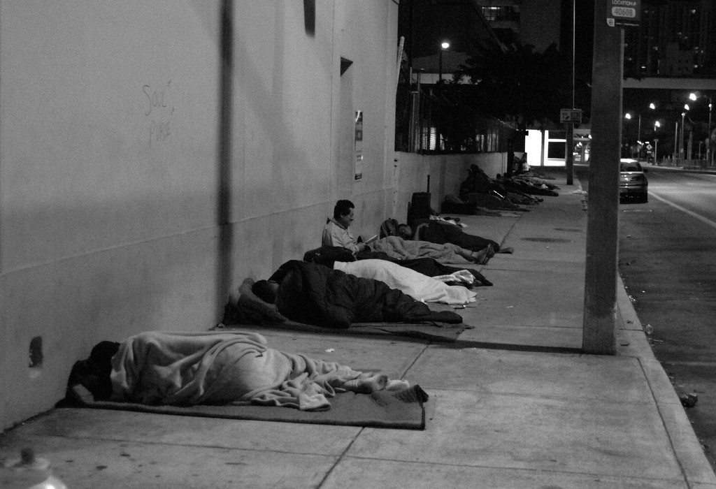 Homelss people sleep in the street.