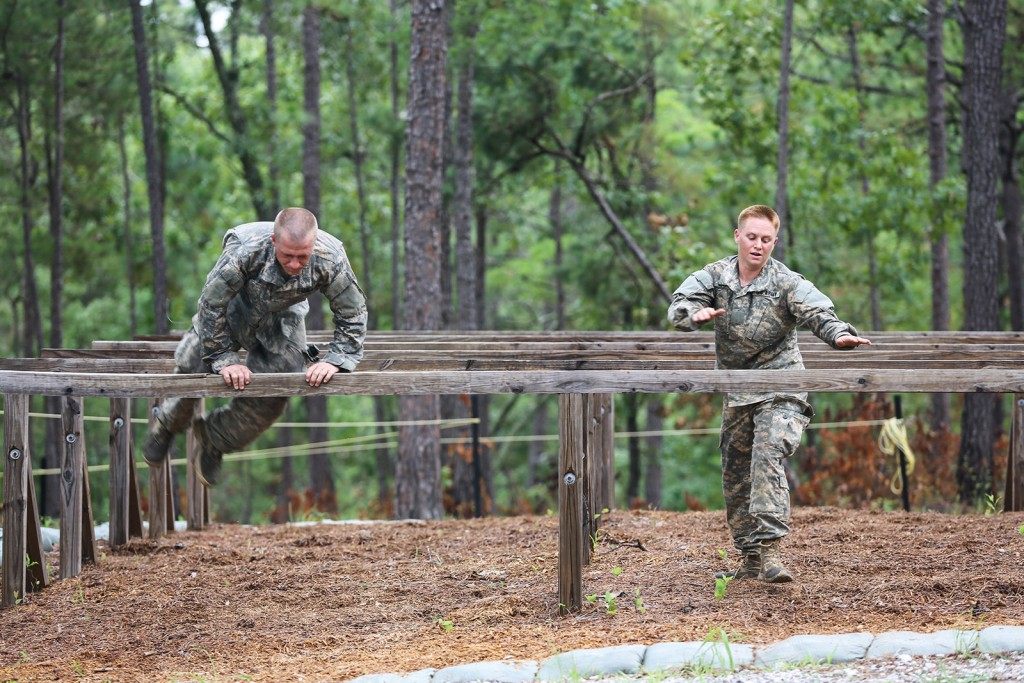 Maj. Lisa Jaster participates in the Darby Queen obstacle course as part of their training at the Ranger Course on Fort Benning, Ga., June 28, 2015. Soldiers attend the Ranger Course to learn additional leadership and small unit technical and tactical skills in a physically and mentally demanding, combat simulated environment. Friday she became the third woman to earn the Ranger Tab. (U.S. Army photo by Staff Sgt. Scott Brooks/ Released)