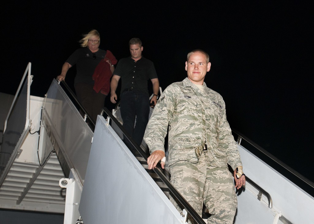 Spencer Stone, the Airman who helped foil a terrorist attack on a train in France, Aug. 21, arrives at Travis Air Force Base, Calif., Sept. 3. Stone was greeted by Airmen and their families including Col. Joel Jackson, 60th Air Mobility Wing commander and Chief Master Sgt. Alan Boling, 60th AMW Command Chief. Stone will receive continued medical treatment for his injuries at David Grant USAF Medical Center. Released (USAF Photo by T.C. Perkins Jr.)