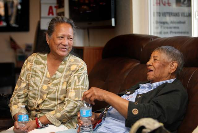 In the offices of Veterans Village, Cynthia Dias, left, who was a Navy corpsman in Vietnam, shares a laugh with 83-year-old Violet Young, who was in the Women's Army Corps during the Korean War. (File photo by Michael Quine/Las Vegas Review-Journal)