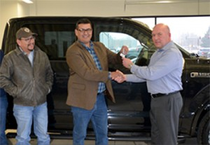 Eide Ford in Bismark, North Dakota, where dealership's general manager, Casey Neumann, presented the keys to MHA Nation Chairman of the Tribe Mark Fox to a brand new Ford F150