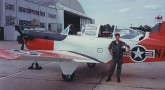 Sam Gordy pictured with an air plane in his Navy days when he was serving as a as Lieutenant JG.