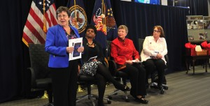 """Image: Left to right: Linda Spoonster Schwartz, VA's Assistant Secretary for Policy and Planning; Barbara Ward, director of VA's Center for Minority Veterans; Karen S. Vartan, a program analyst in VA's Navigation, Advocacy & Community Engagement; and Vice President of Vietnam Veterans of America and Bronze Star Medal recipient, Marsha Tansey Four, speak at last month's Center for Women Veterans' event at VA Central Office, Washington, DC. The event saluted women Veterans who served during the Vietnam War Commemoration period of Nov. 1, 1955, to May 15, 1975, and closed with an official pinning ceremony to recognize the Veterans in attendance who served on active duty during that period; each received a lapel pin with the inscription: """"A grateful nation thanks and honors you."""""""
