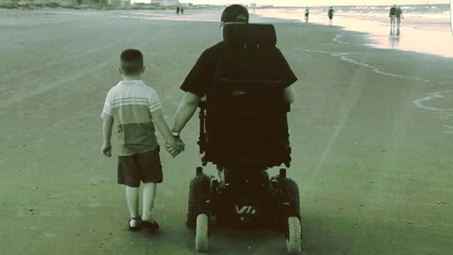 Veteran, son take first stroll on the beach thanks to VA employee