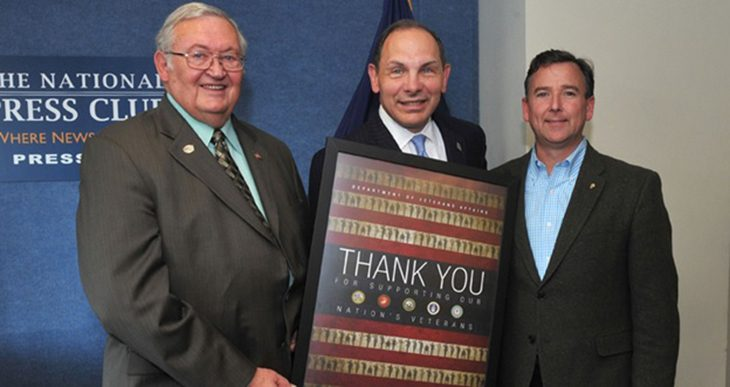 Image of VA Secretary Bob McDonald thanking Paul Helsel and Shawn Bullard of the National Elks Lodge Organization for its partnership in serving Veterans and their families. (VA photo/Robert Turtil)