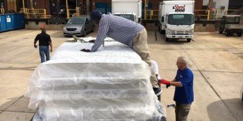 Image of men at Jennings Bryan Dorn VA Medical Center unloading mattresses