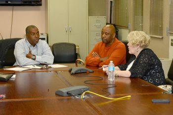 Formerly homeless Veteran and bed recipient William McCullough, center, shares his experience with Dorn VAMC staff.