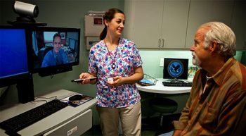 Image of a patient and nurse using video camera